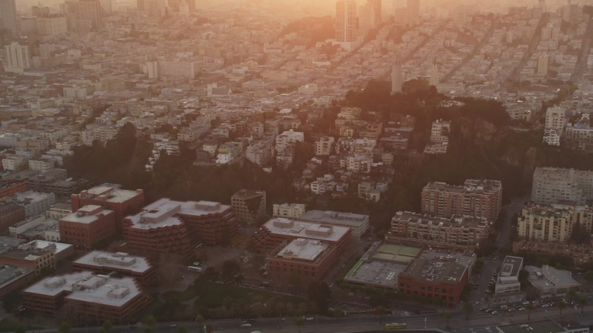 5K stock footage aerial video of flying by iconic Coit Tower in North Beach, San Francisco, California, sunset Aerial Stock Footage | DFKSF14_019