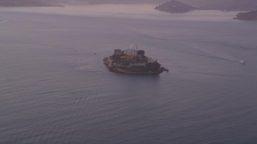 Approaching Alcatraz, San Francisco, California, sunset Aerial Stock Footage | DFKSF14_020
