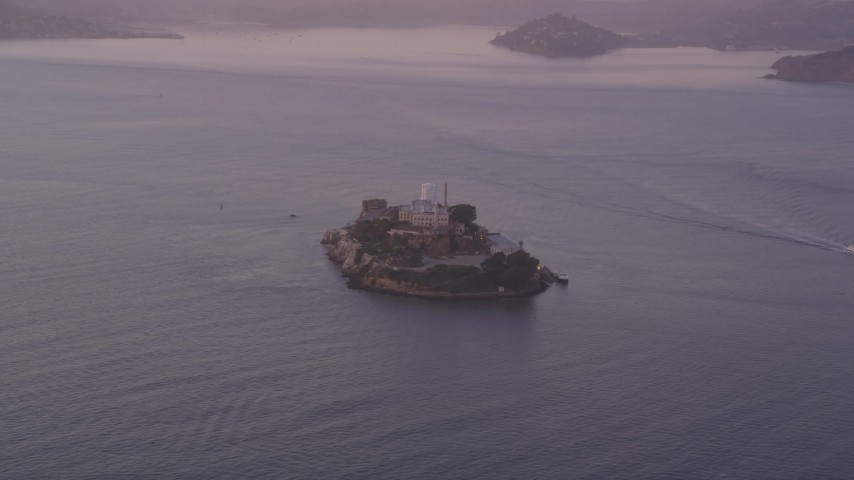 5K stock footage aerial video of approaching Alcatraz island prison, San Francisco, California, twilight Aerial Stock Footage | DFKSF14_020