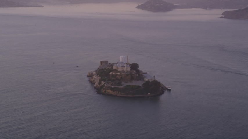 5K stock footage aerial video of approaching Alcatraz island prison slowly, San Francisco, California, twilight Aerial Stock Footage | DFKSF14_021