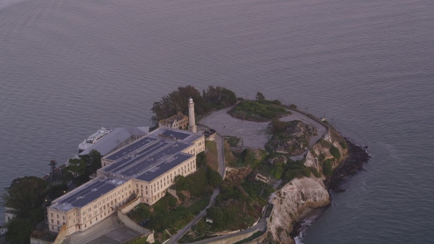 5K stock footage aerial video of the main buildings and lighthouse on Alcatraz island, San Francisco, California, twilight Aerial Stock Footage | DFKSF14_024
