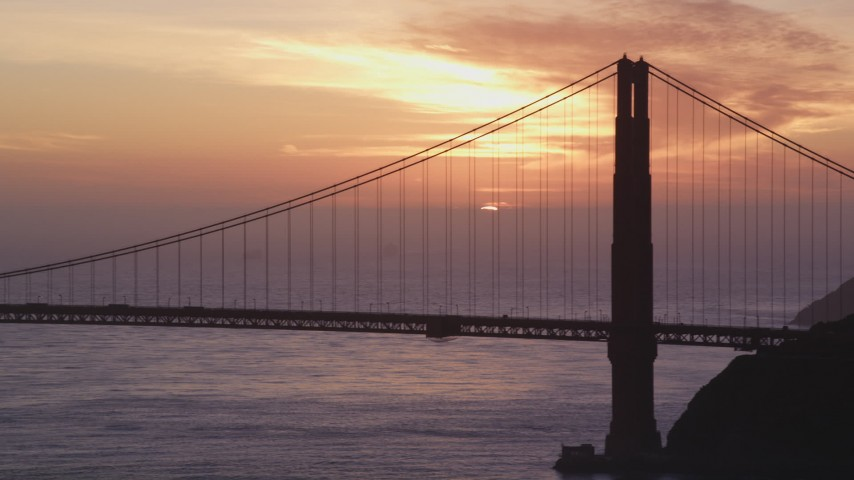 5K stock footage aerial video of the setting sun behind the Golden Gate Bridge in San Francisco, California, sunset Aerial Stock Footage | DFKSF14_026