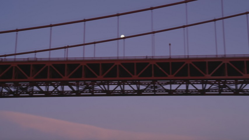 5K stock footage aerial video flyby Golden Gate Bridge, moon visible between cables, San Francisco, California, twilight Aerial Stock Footage | DFKSF14_033