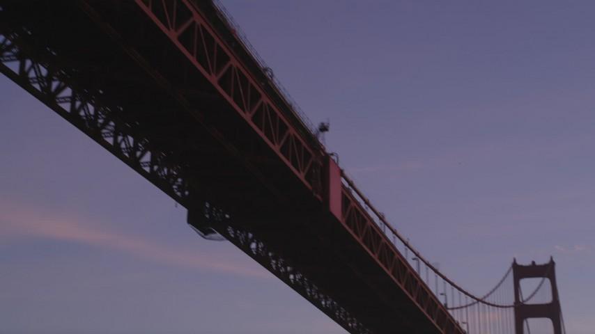 5K stock footage aerial video of flying by underside of Golden Gate Bridge, San Francisco, California, twilight Aerial Stock Footage | DFKSF14_034