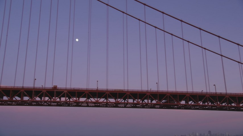 5K stock footage aerial video of flying by the Golden Gate Bridge with a view of the moon, San Francisco, California, twilight Aerial Stock Footage | DFKSF14_035