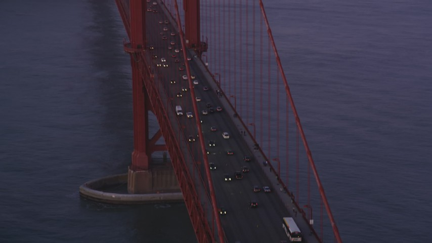 5K stock footage aerial video of traffic on famous Golden Gate Bridge in San Francisco, California, twilight Aerial Stock Footage | DFKSF14_036