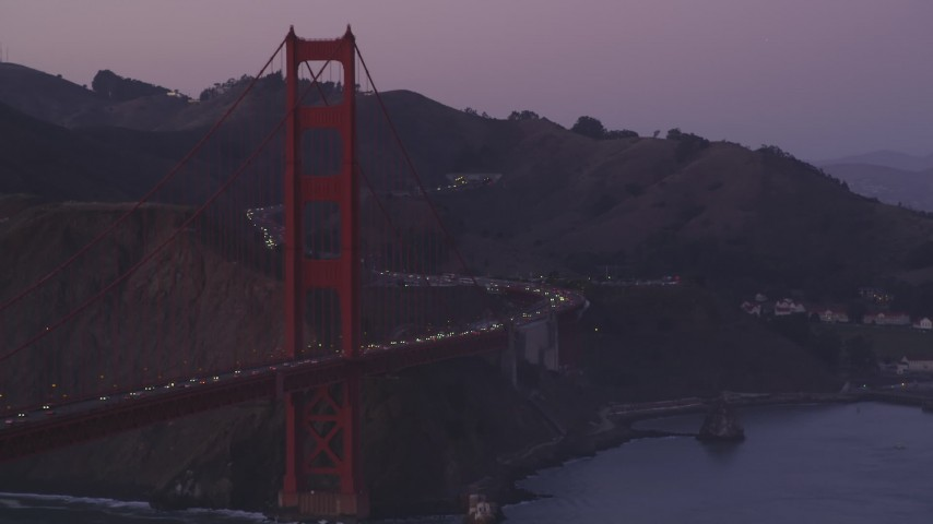 5K stock footage aerial video of a reverse view of traffic on the Marin side of the Golden Gate Bridge, San Francisco, California, twilight Aerial Stock Footage | DFKSF14_037