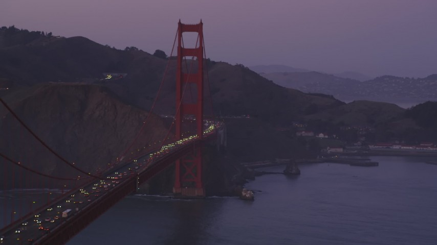 5K aerial video of passing by the iconic Golden Gate Bridge, San Francisco, California, twilight Aerial Stock Footage | DFKSF14_038