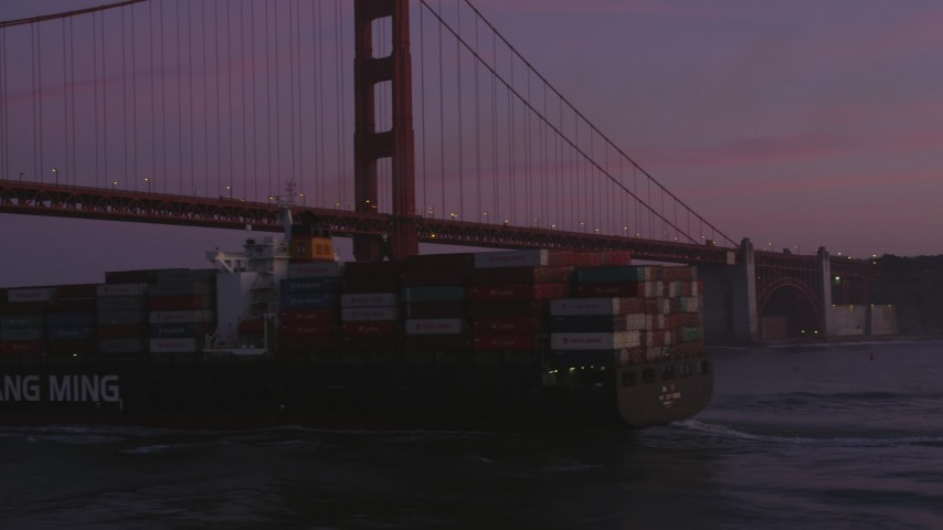 5K stock footage aerial video orbit cargo ship and reveal Golden Gate Bridge, San Francisco, California, twilight Aerial Stock Footage | DFKSF14_041