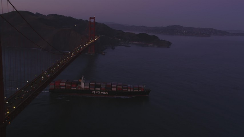 5K stock footage aerial video fly over Golden Gate Bridge, reveal cargo ship, San Francisco, California, twilight Aerial Stock Footage | DFKSF14_042