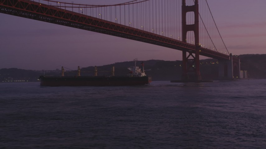 5K aerial video approach oil tanker sailing under Golden Gate Bridge, San Francisco, California, twilight Aerial Stock Footage | DFKSF14_046