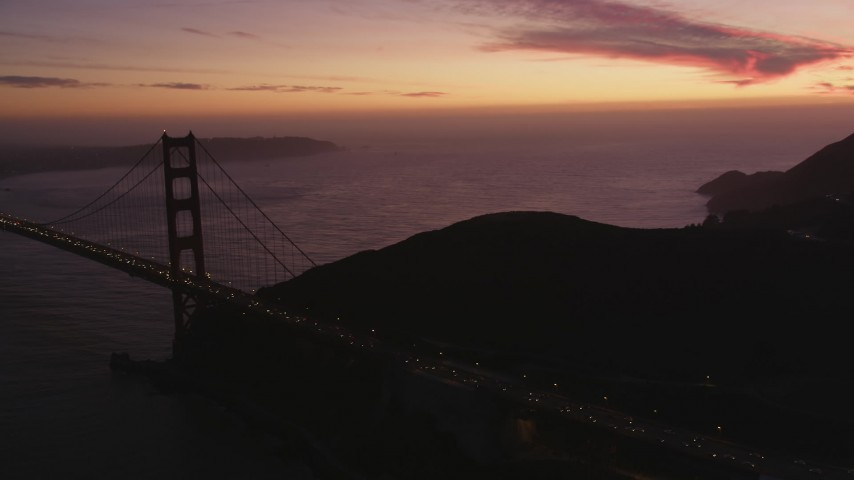 5K stock footage aerial video of flying by Marin side of the Golden Gate Bridge, San Francisco, California, twilight Aerial Stock Footage | DFKSF14_050