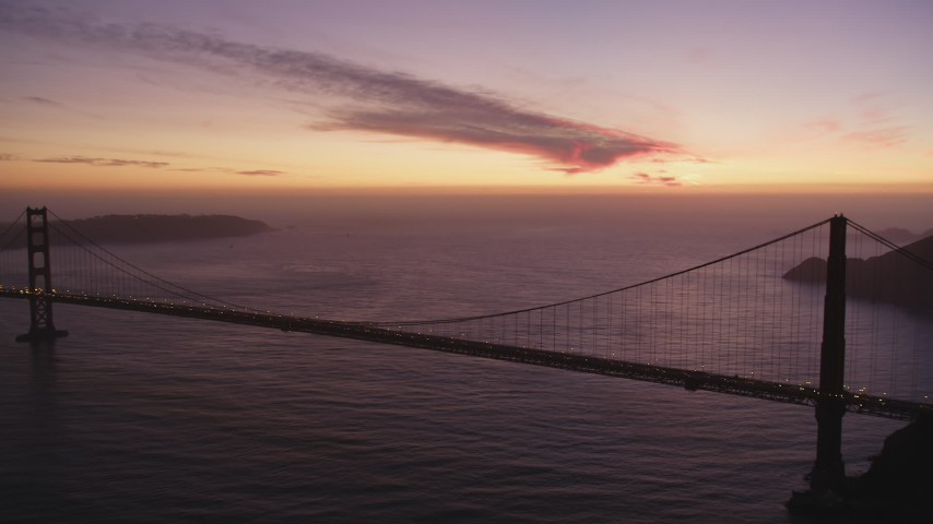5K stock footage aerial video of flying away from the Golden Gate Bridge, San Francisco, California, twilight Aerial Stock Footage | DFKSF14_052