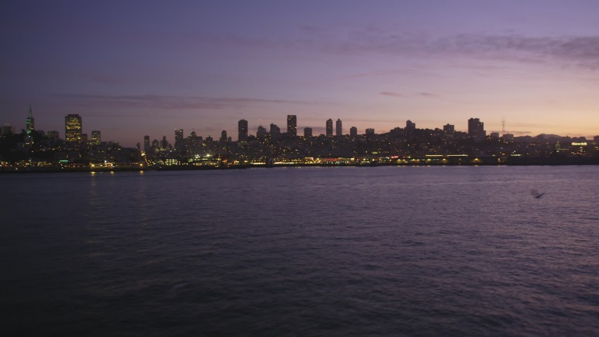 5K stock footage aerial video of Russian Hill, Coit Tower and Fisherman's Wharf, San Francisco, California, twilight Aerial Stock Footage | DFKSF14_059