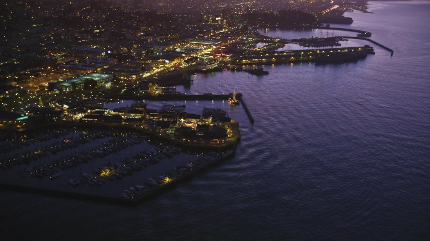 5K stock footage aerial video of flying away from Pier 39. and Fisherman's Wharf in San Francisco, California, twilight Aerial Stock Footage | DFKSF14_060