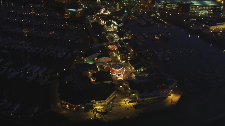 5K stock footage aerial video approach and fly over Pier 39 in San Francisco, California, night Aerial Stock Footage | DFKSF14_062