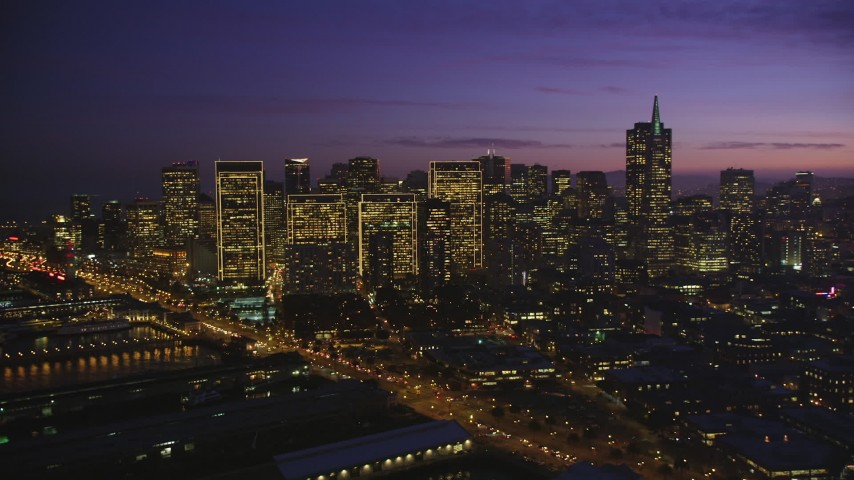 5K stock footage aerial video of flying by skyscrapers at twilight in Downtown San Francisco, California Aerial Stock Footage | DFKSF14_063