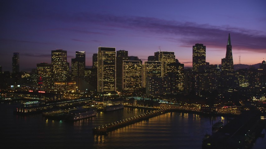 5K stock footage aerial video of flying by tall city skyscrapers in Downtown San Francisco, California, twilight Aerial Stock Footage   DFKSF14_064