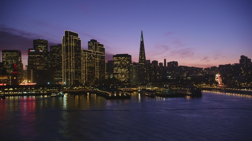 5K stock footage aerial video of passing waterfront skyscrapers in Downtown San Francisco, California, twilight Aerial Stock Footage | DFKSF14_066