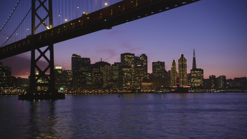 5K stock footage aerial video of city skyscrapers, revealing Bay Bridge, Downtown San Francisco, California, twilight Aerial Stock Footage | DFKSF14_068