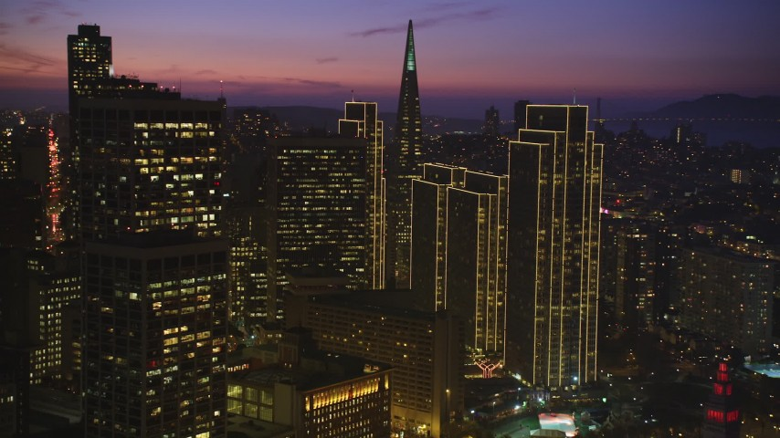 5K stock footage aerial video pan across skyscrapers near Transamerica Pyramid in Downtown San Francisco, California, twilight Aerial Stock Footage | DFKSF14_070