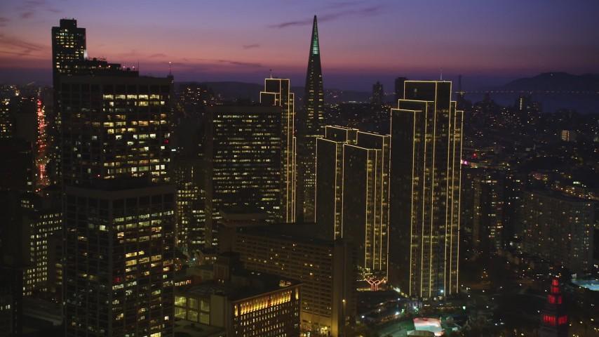 5K aerial video pan across skyscrapers near Transamerica Pyramid in Downtown San Francisco, California, twilight Aerial Stock Footage | DFKSF14_070