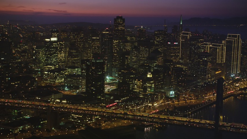 5K stock footage aerial video of skyscrapers seen from Bay Bridge, Downtown San Francisco, California, twilight Aerial Stock Footage | DFKSF14_071