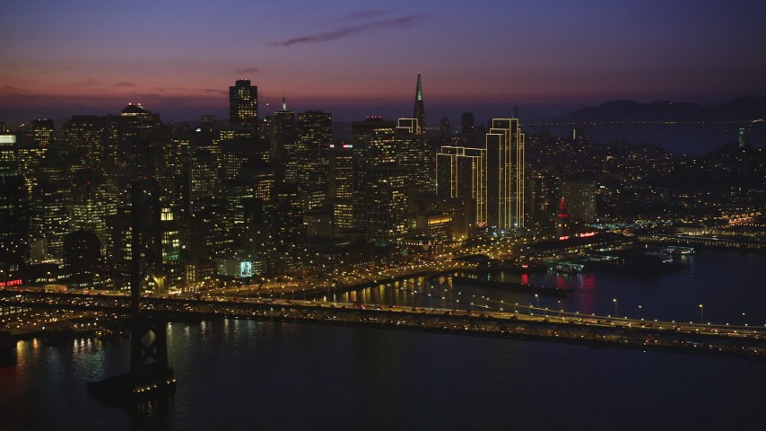 5K aerial video of Downtown San Francisco skyscrapers and the Bay Bridge, California, twilight Aerial Stock Footage | DFKSF14_072