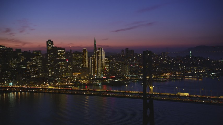 5K stock footage aerial video of the Bay Bridge and Downtown San Francisco skyscrapers, California, twilight Aerial Stock Footage | DFKSF14_073