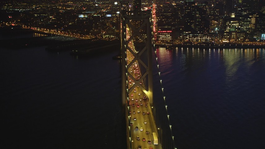 5K stock footage aerial video of heavy traffic on upper deck of Bay Bridge, San Francisco, California, twilight Aerial Stock Footage | DFKSF14_075