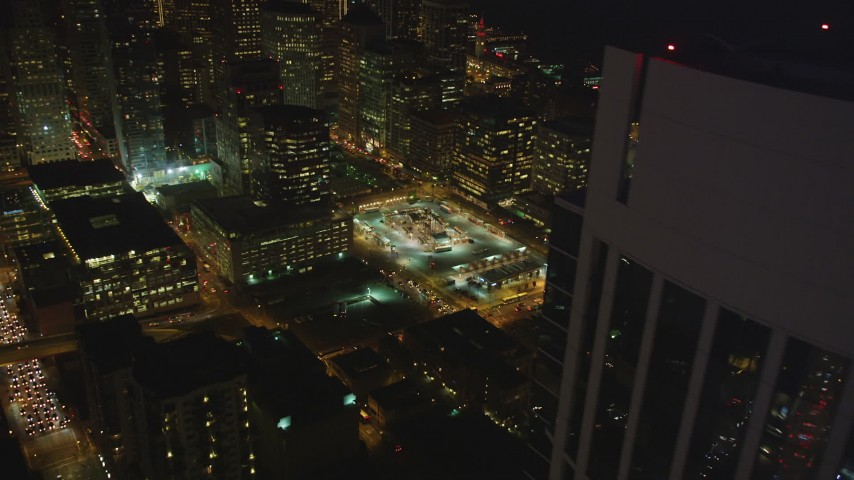 5K stock footage aerial video flyby One Rincon Hill skyscraper toward bus station in Downtown San Francisco, California, night Aerial Stock Footage | DFKSF14_079