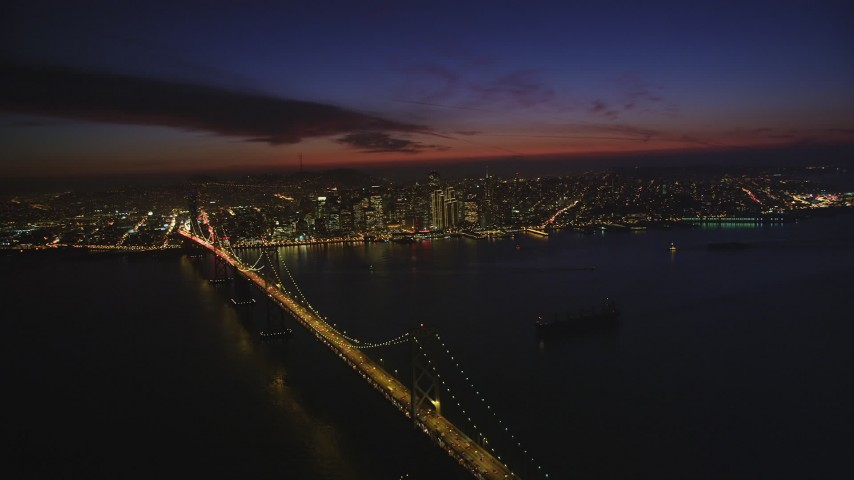 5K stock footage aerial video of downtown skyscrapers seen while hovering over Bay Bridge, Downtown San Francisco, California, night Aerial Stock Footage | DFKSF14_083