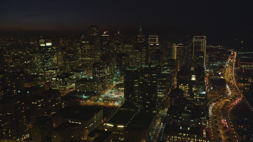 5K stock footage aerial video of tall city skyscrapers seen from Bay Bridge, Downtown San Francisco, California, night Aerial Stock Footage | DFKSF14_089