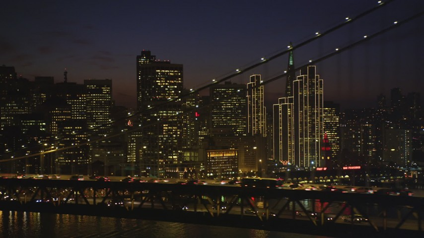 5K stock footage aerial video of city skyscrapers seen from behind Bay Bridge, Downtown San Francisco, California, night Aerial Stock Footage | DFKSF14_091