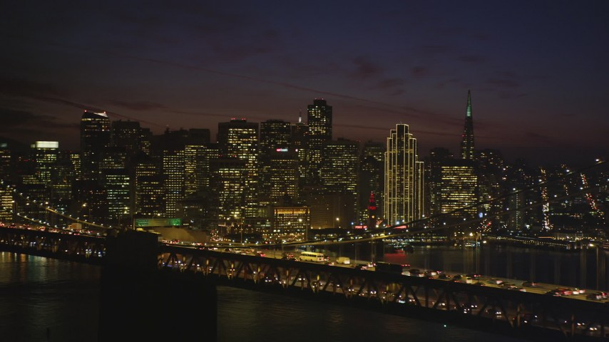 5K stock footage aerial video of Downtown San Francisco's skyscrapers seen from the Bay Bridge, California, night Aerial Stock Footage | DFKSF14_092
