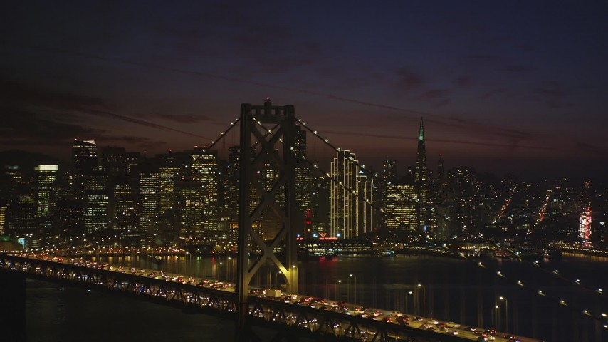 5K stock footage aerial video of waterfront skyscrapers seen from Bay Bridge, Downtown San Francisco, California, night Aerial Stock Footage | DFKSF14_093