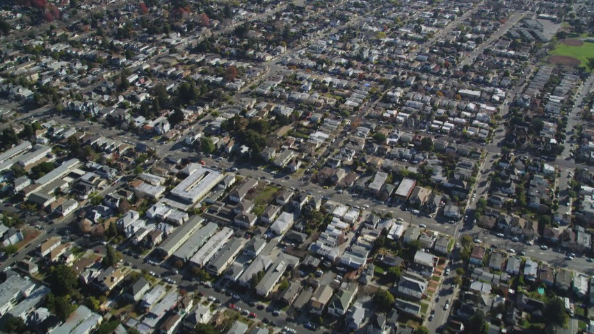 5K stock footage aerial video of a reverse view of suburban neighborhoods, Alameda, California Aerial Stock Footage | DFKSF15_001