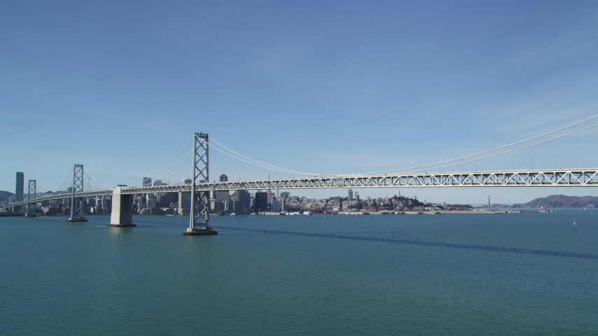 5K stock footage aerial video of tilting from the bay revealing Bay Bridge and Downtown San Francisco, California Aerial Stock Footage | DFKSF15_005