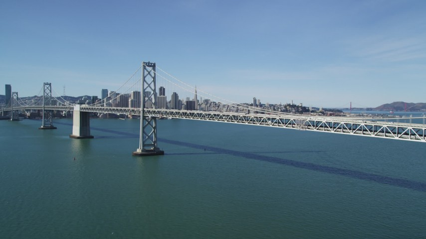 5K stock footage aerial video of approaching the Bay Bridge, with views of Downtown San Francisco skyline, California Aerial Stock Footage | DFKSF15_006
