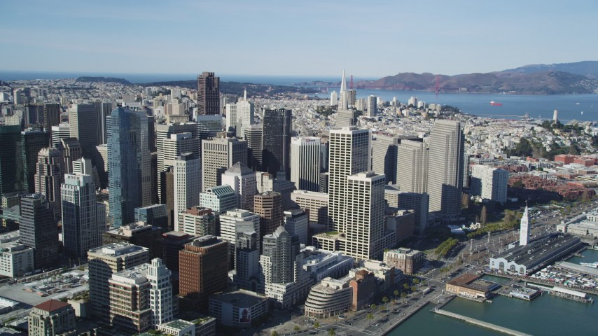 5K stock footage aerial video of flying by the city's bay front skyscrapers in Downtown San Francisco, California Aerial Stock Footage | DFKSF15_009