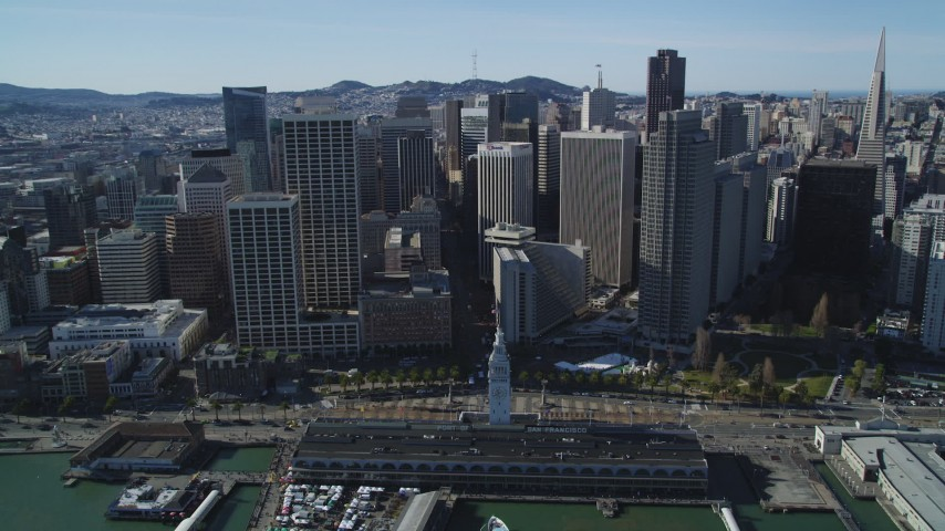 5K stock footage aerial video of flying away from the Ferry Building and skyscrapers in Downtown San Francisco, California Aerial Stock Footage | DFKSF15_013