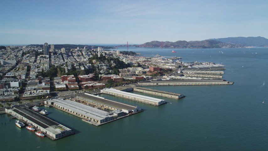 5K stock footage aerial video flyby Coit Tower and North Beach piers, view of Golden Gate Bridge, San Francisco, California Aerial Stock Footage | DFKSF15_014