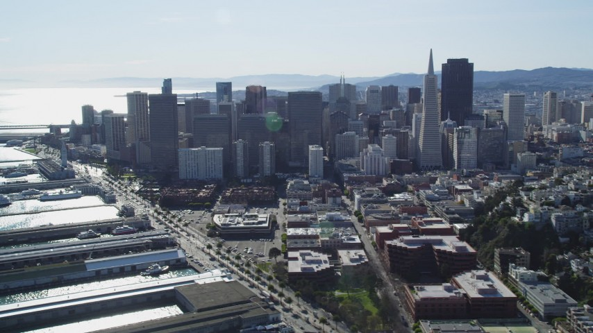 5K stock footage aerial video of flying by Transamerica Pyramid and skyscrapers in Downtown San Francisco, California Aerial Stock Footage | DFKSF15_016