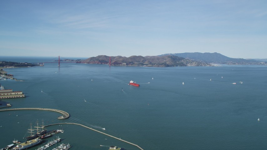 5K stock footage aerial video of approaching an oil tanker sailing San Francisco Bay, California with a view of the Golden Gate Bridge Aerial Stock Footage | DFKSF15_018