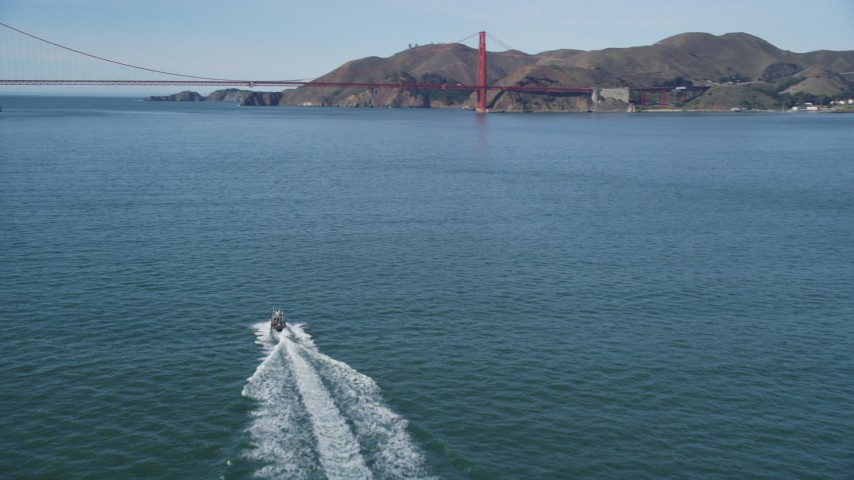 5K aerial video of approaching boat on the bay, tilt to reveal Golden Gate Bridge, San Francisco, California Aerial Stock Footage | DFKSF15_022
