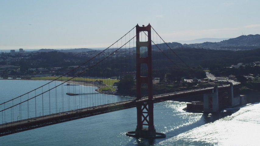 Flying by a tower on the Golden Gate Bridge, San Francisco, California Aerial Stock Footage | DFKSF15_030