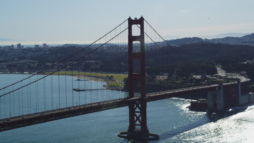 5K stock footage aerial video of flying by a tower on the Golden Gate Bridge, San Francisco, California Aerial Stock Footage | DFKSF15_030