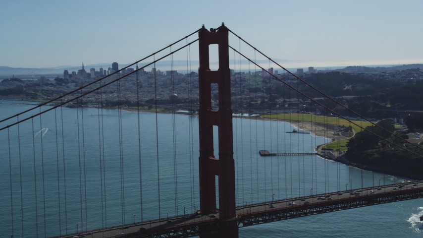 5K stock footage aerial video of flying by Golden Gate Bridge, reveal Downtown San Francisco skyline, California Aerial Stock Footage | DFKSF15_031
