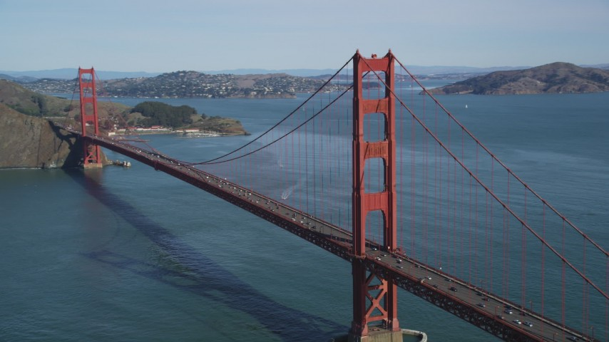 5K stock footage aerial video of flying by tower to pan across Golden Gate Bridge, San Francisco, California Aerial Stock Footage | DFKSF15_032