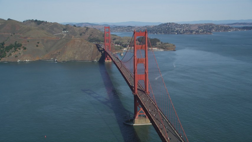 Flying by the Golden Gate Bridge with light traffic, San Francisco, California Aerial Stock Footage | DFKSF15_033